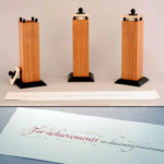 hand-crafted wood trophies with carving and calligraphy